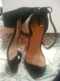 pair of black leather open-toe ankle strap heels