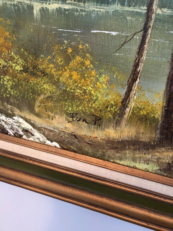 Painting of mountains and lake 980a7b15-3fb8-4582-9721-67a74b62a277