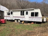 White and red travel trailer Bluefield, 24605