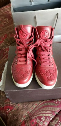 pair of red gucci high-top sneakers size 9