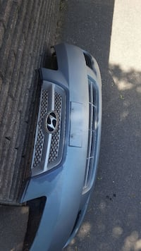 gray Hyundai front bumper with grille