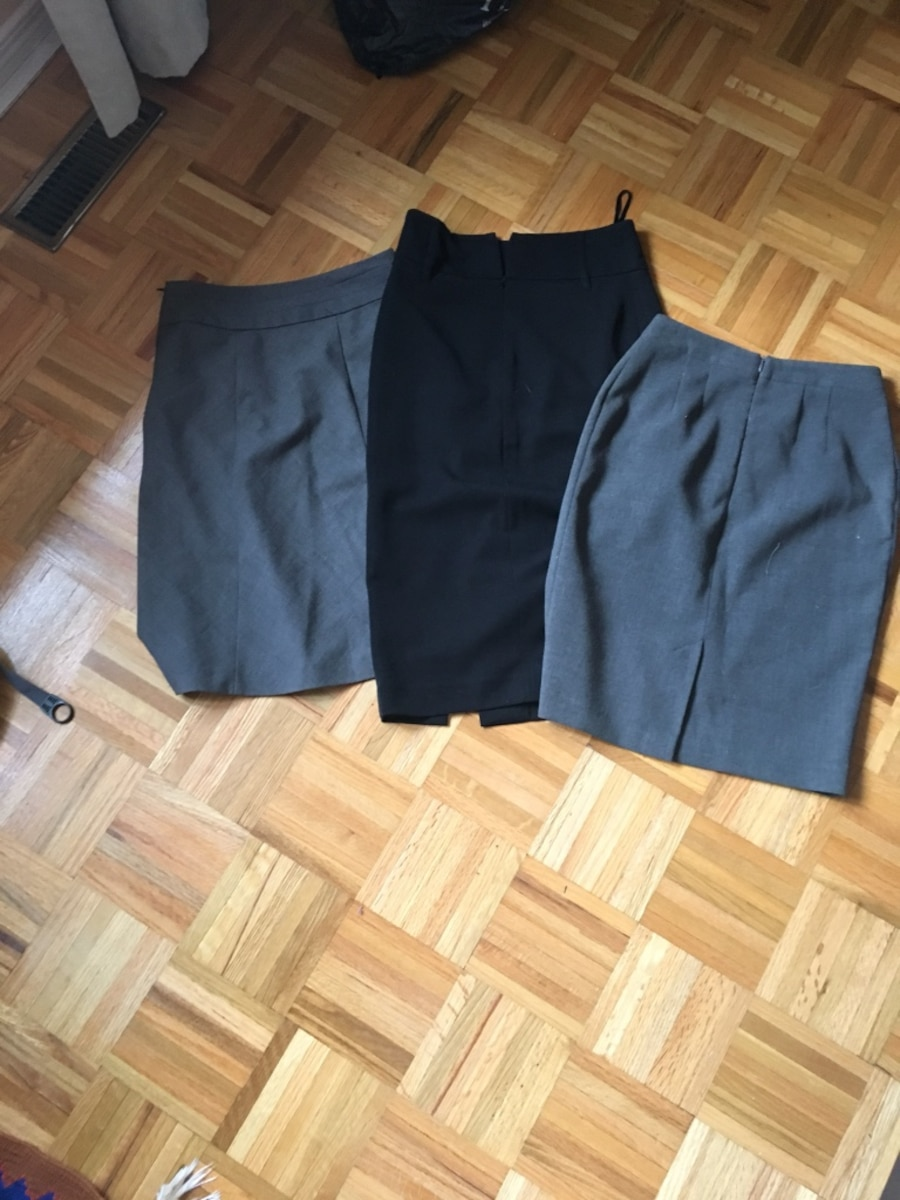 two gray and one black skirts - $60