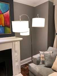 Modern, stylish floor lamp. Each lamp can be turned on/off individually. Pick up at Yonge and Lawrence. Toronto, M4N 1W9