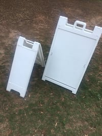 Two white wooden folding signages