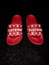 pair of red-and-white Adidas slide sandals Montréal, H4L 3M8