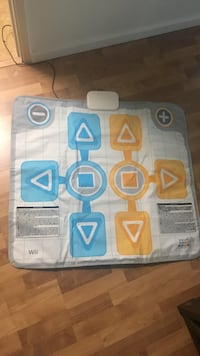 white, blue, and yellow dance pad