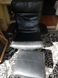 black leather armchair and ottoman