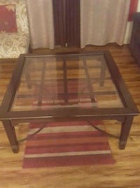 rectangular brown wooden framed glass top coffee table Murfreesboro, 37130
