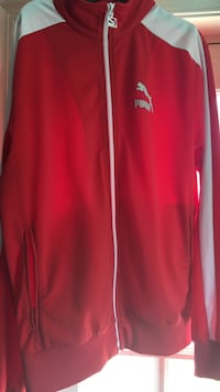 Red and white puma zip-up track runner 25 mi
