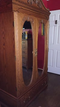 Carved oak armoire/tv cabinet and carved oak sleigh bed both pieces very heave real oak not cheap furniture also comes with queen size mattress and boxspring. Not smoking house Leonardtown, 20650