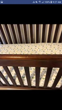 brown wooden crib with white mattress Toronto, M8V 1S3