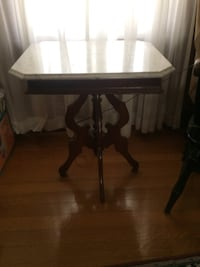 Brown wooden pedestal square table
