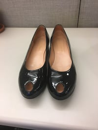 pair of black leather mary jane shoes New York, 10022