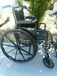 black and gray motorized wheelchair Los Angeles, 91605