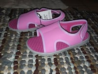 pair of pink-and-white Nike sneakers Oil City, 16301