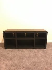 black wooden TV stand with cabinet 520 mi
