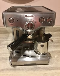 "Breville Espresso Machine 800ESXL, includes stainless steel frothing jug. measures L10""x W10""x H12"". A functional showpiece. Bought for Italian visitors but used 2 times only. 15- bar Italian made pump, pre-brew function, auto purge, thermal block heat sy"