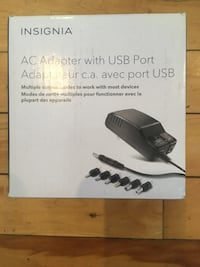 Insignia AC Adapter With USB Port.