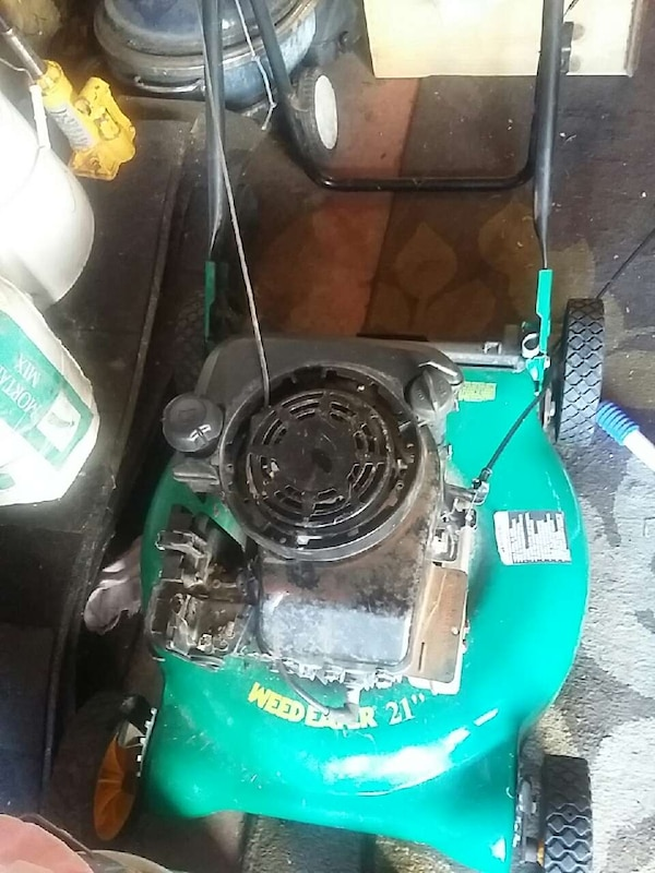 Used lawn mower for parts or if u can fix I locked up for