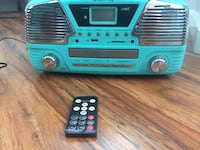 teal and gray boombox with black remote control