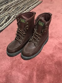 Leather boots. New just sit in garage. 70 obo cabelas brand