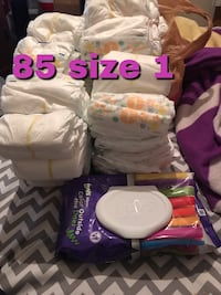 Size 1 diapers and 1 pack of wipes  1035 mi
