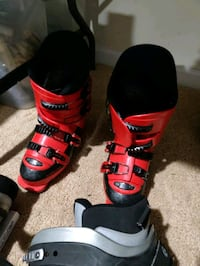 pair of black-and-red snow boots 44 mi