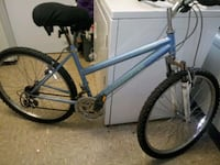 blue and black hard tail mountain bike Knoxville, 37921