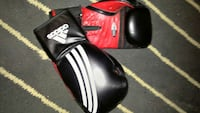 black-and-red Adidas boxing gloves