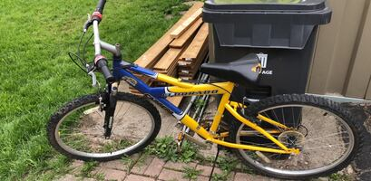Yellow and blue hard tail mountain bike