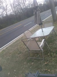 Patio table three chairs side table umbrella