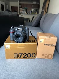 black Canon EOS DSLR camera with box Arlington, 22201