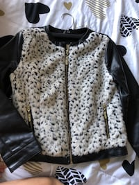 black and white fur-line leather jacket