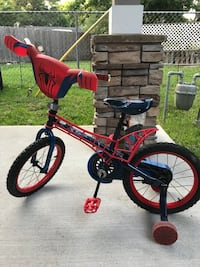 toddler's red and black bicycle with training wheels 43 km