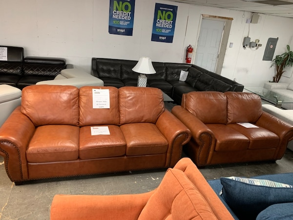 Light Brown Leather Sleeper Sofa and Loveseat Set