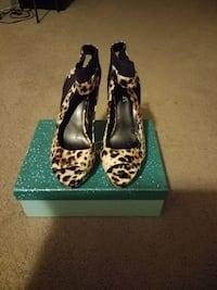 pair of women's black-and-brown leopard print peep-toe slingback ankle strap heels with box