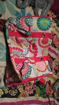 White, pink, teal, and green floral handbag