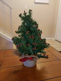 Cute little decorative Christmas tree with berries