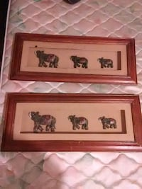 two brown wooden framed paintings 264 mi