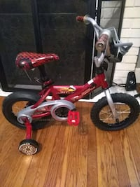 toddler's red and white bicycle with training whee Baltimore, 21229