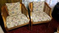 two brown wooden framed padded armchairs 511 mi