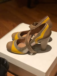 pair of brown-and-yellow leather round-toe chunky heel pumps