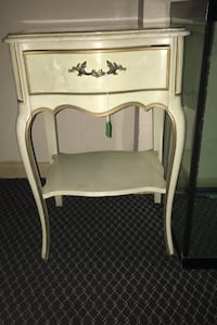 Louis XV bedside table with serpentine drawer front.