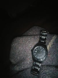 black pulsar watch with black face