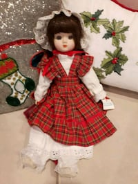 doll in red and white dress 572 km