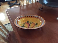 orange and yellow ceramic bowl