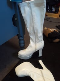 pair of white leather chunky heeled platform zip-side thigh-high boots
