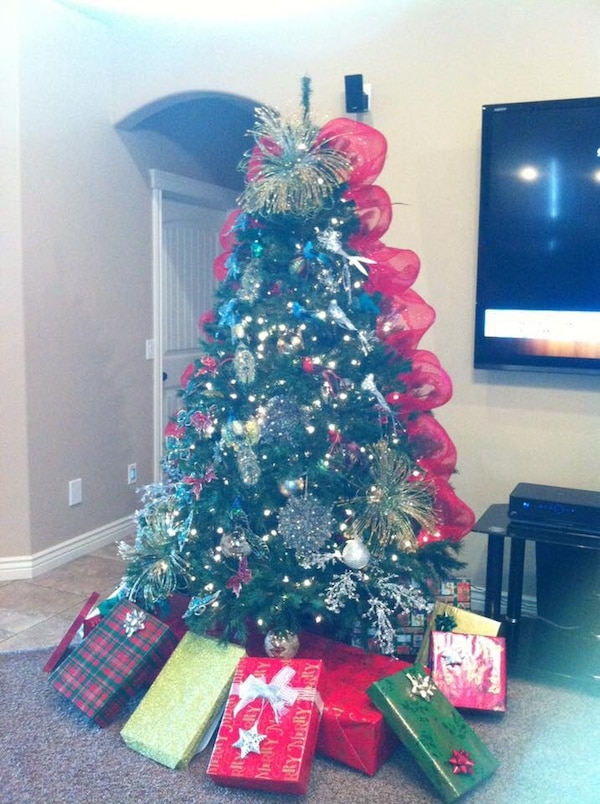 Christmas tree 7.5 ft mixed jasmine fir tree. Sale only tree. No lights or