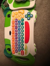 green and white learning toy