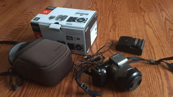Black sony NEX 5n with lens, two batteries, charger, and case. Don't respond with I'm interested. Please propose a time